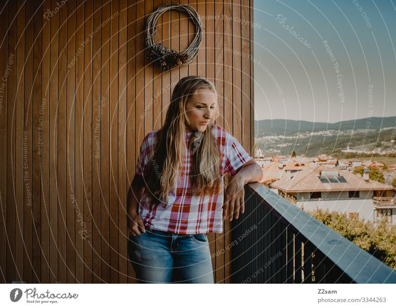 Young woman in Italy Vacation mood Balcony country country house Southern Warm light Summer Summer vacation Blonde Woman pretty Girl youthful Meditative jeans