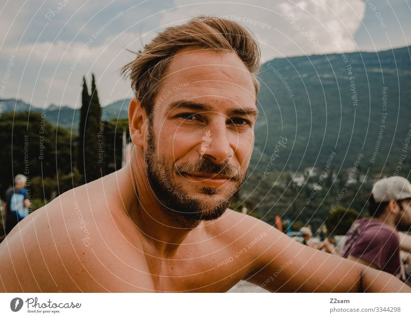 Man chilling on the beach in Torbole Lake Garda Beach Relaxation contented fortunate Freedom free time vacation mountains portrait Facial hair youthful
