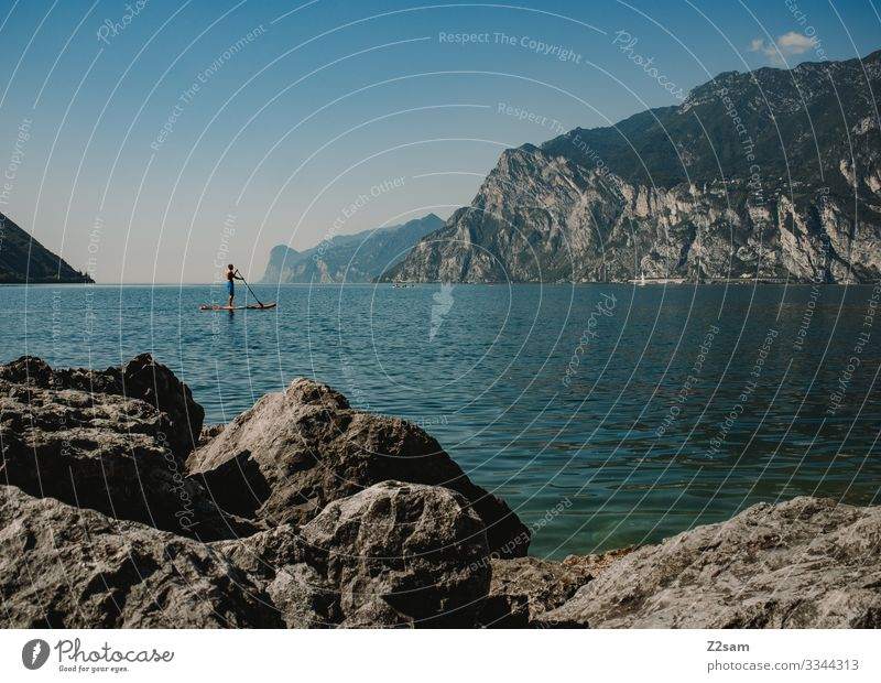 SUP on Lake Garda | Torbole Lakeside Water Aquatics bank stones Rock Nature Blue Mountain Exterior shot Colour photo Landscape Italy Summer Vacation & Travel