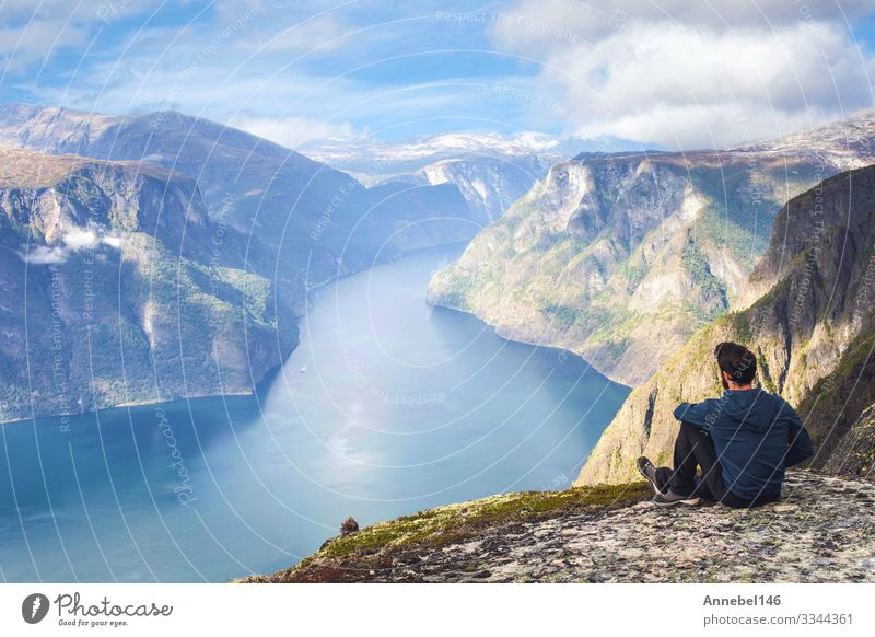 Man sitting on cliff edge alone enjoying aerial view backpacking Lifestyle Vacation & Travel Tourism Trip Adventure Freedom Ocean Island Mountain Hiking Success