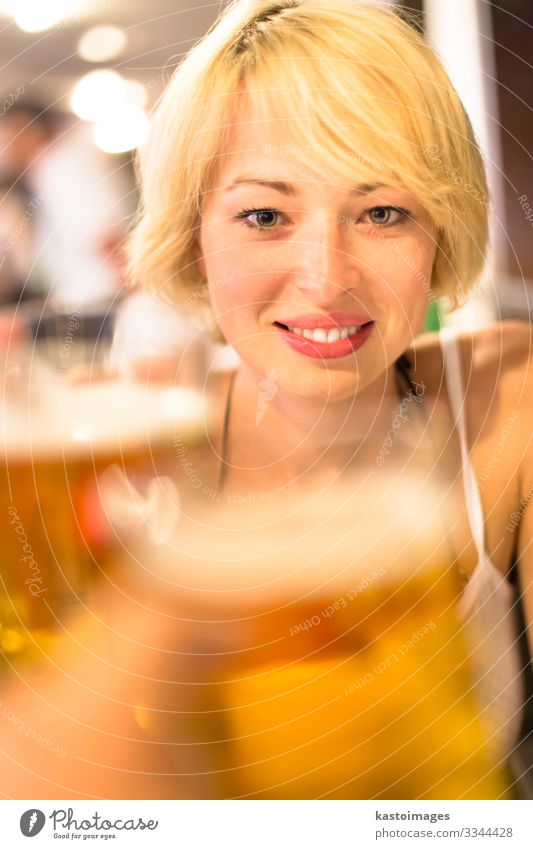 Lady toasting with a pint of beer. Beverage Alcoholic drinks Beer Lifestyle Joy Relaxation Leisure and hobbies Night life Flirt Feasts & Celebrations
