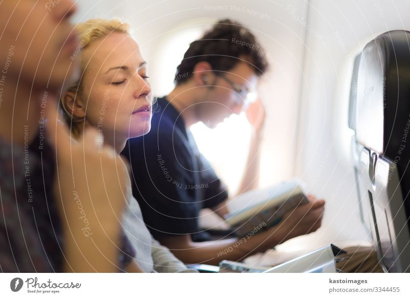 People flying by plane. Vacation & Travel Tourism Trip Chair Economy Business Aviation Woman Adults Hut Transport Airplane Aircraft Flight Attendant Sleep Dream