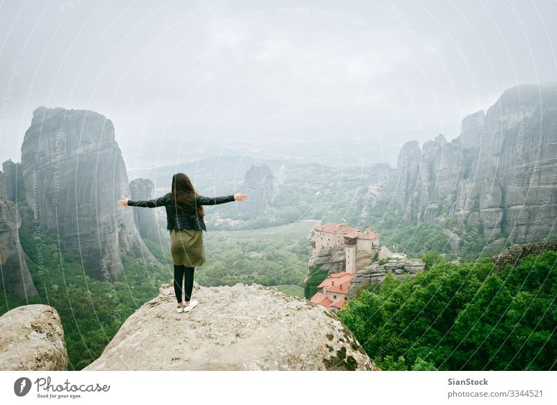 Girl enjoys the view of great and high rock in Meteora, Greece Beautiful Vacation & Travel Tourism Summer Mountain Hiking Woman Adults Culture Nature Landscape