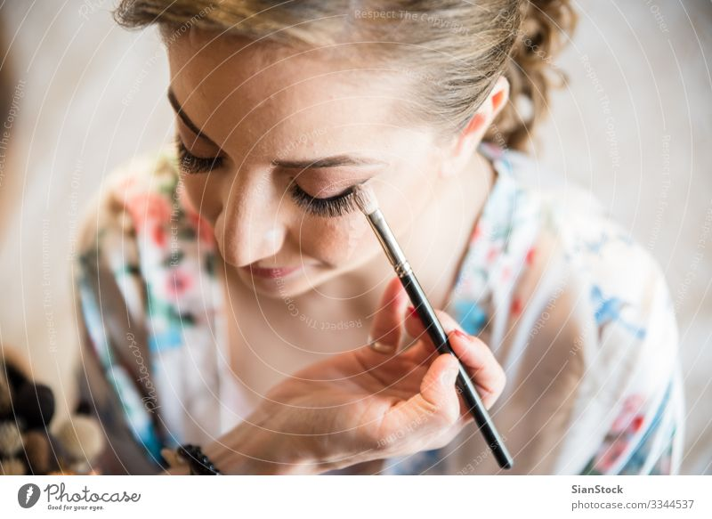 Makeup artist preparing bride before the wedding. Beautiful Face Make-up Lipstick Wedding Work and employment Woman Adults Fashion Bride Beauty Photography