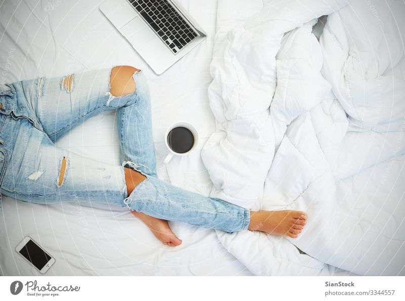 Young woman drinking coffee at home in her bed top view Coffee Beautiful Life Relaxation Reading Bedroom Work and employment Workplace Telephone PDA Computer