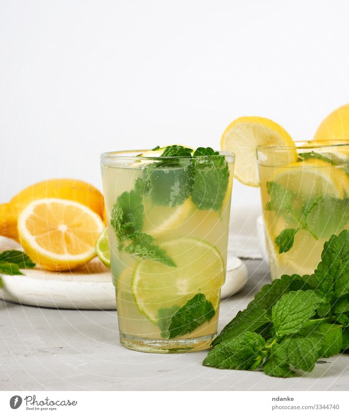 summer refreshing drink lemonade Fruit Candy Herbs and spices Beverage Lemonade Juice Alcoholic drinks Summer Table Leaf Cool (slang) Fresh Juicy Sour Yellow