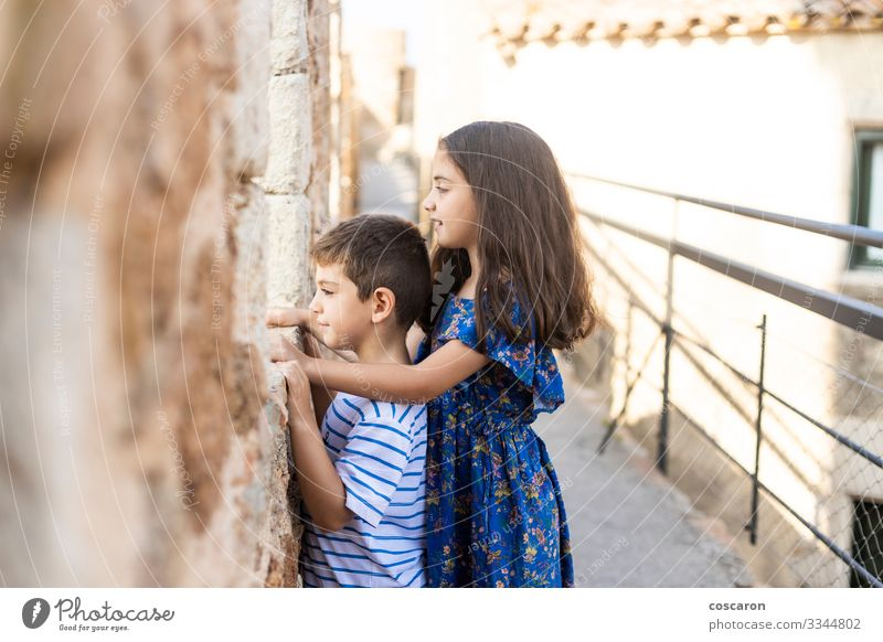 Two kids looking throw the wall of a castle Joy Happy Vacation & Travel Tourism Summer Summer vacation Child School Human being Masculine Feminine Toddler