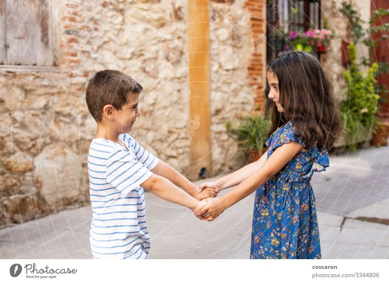 Two children holding hands on a spring day Lifestyle Joy Happy Beautiful Vacation & Travel Summer Summer vacation Child Human being Masculine Feminine Toddler