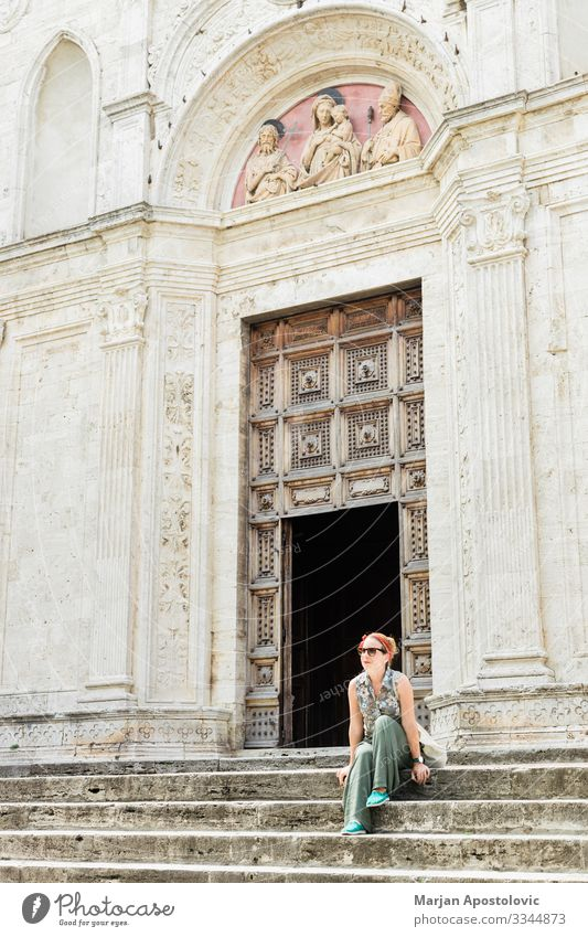 Young woman on church steps in old town in Italy Lifestyle Vacation & Travel Tourism Trip Sightseeing City trip Human being Feminine Youth (Young adults) Woman