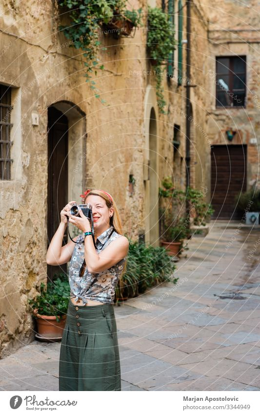 Young woman taking photo in an old town in Italy Lifestyle Vacation & Travel Tourism Trip Sightseeing City trip Camera Human being Feminine Youth (Young adults)