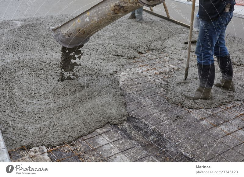 workers pouring wet concrete using concrete bucket. Work and employment Construction site Industry Business Building Street Concrete Steel Wet cement mix