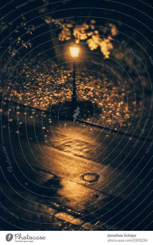 Streetlight at night in autumn from bird's eye view streetlamp Night Autumn Rain conceit somber Bird's-eye view Lantern foliage Light Lamp Exterior shot