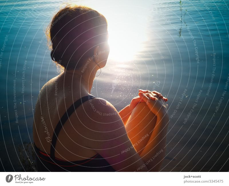 15 minutes daily Sunbathing Summer Beautiful weather Lake Swimsuit Brunette Braids Sit Bright Warmth Emotions Safety (feeling of) Attentive Experience Serene