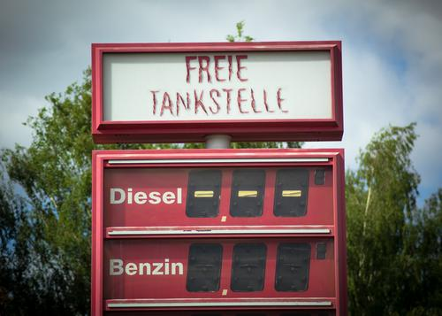 Diesel Petrol and End Trade Petrol station Energy crisis Summer Tree Kreuzberg Price list Typography Gasoline Display Sharp-edged Free Broken Retro Warmth Red
