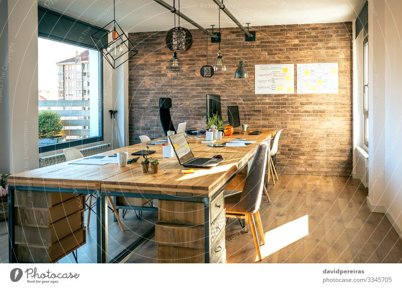 Interior of industrial style coworking office Design Decoration Lamp Desk Chair Table Workplace Office Business Computer Notebook Plant Cactus Wood Modern