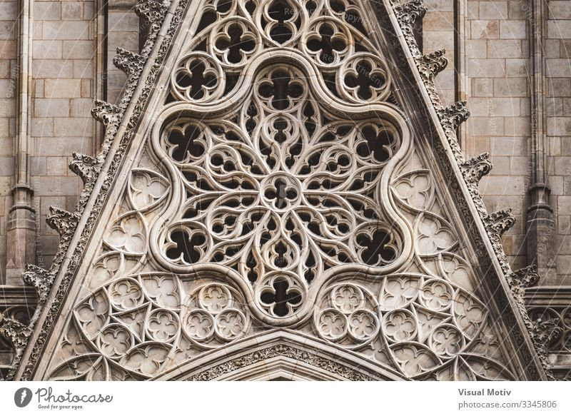 Detail of a rose window and sculpted filigrees at the front of a gothic cathedral basilica architecture architectural carving sacred color outdoor exterior