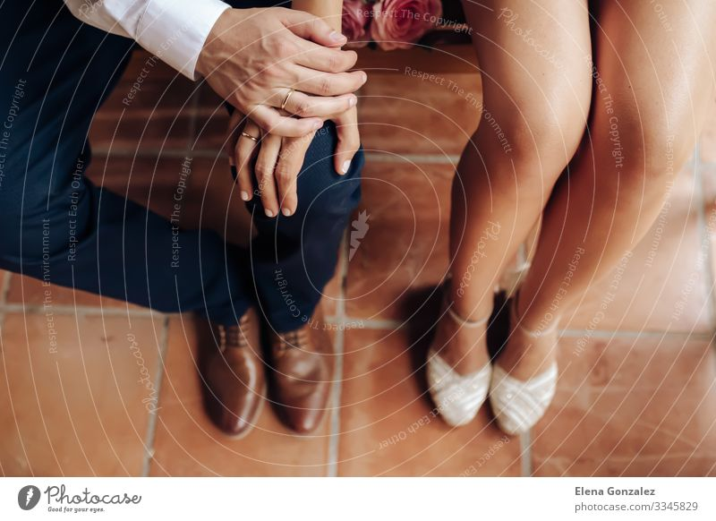 Top view of Newlywed with their rings. Shoes of groom and bride. Feasts & Celebrations Wedding Feminine Woman Adults Hand Rose Footwear Bouquet Love Together