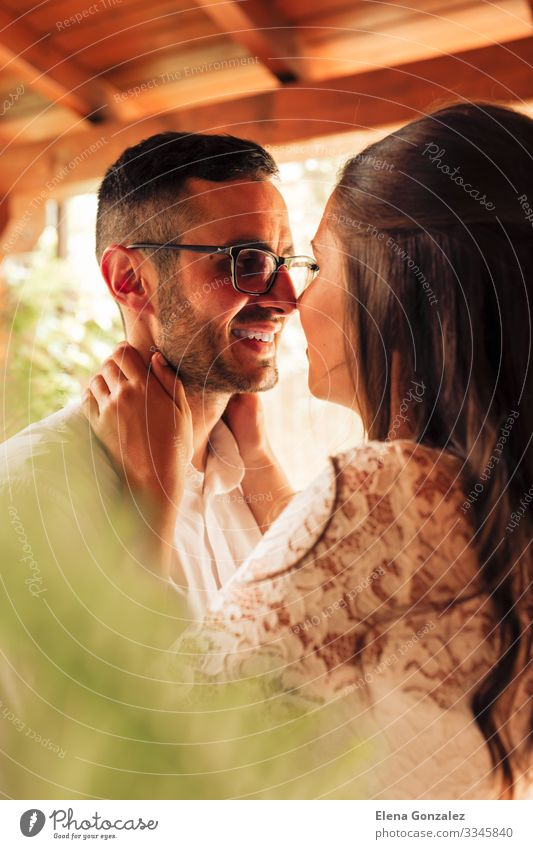 Close up portrait of newlywed couple caressing Feasts & Celebrations Wedding Woman Adults Man Fingers Rose Bouquet Kissing Love Emotions Romance Eternity