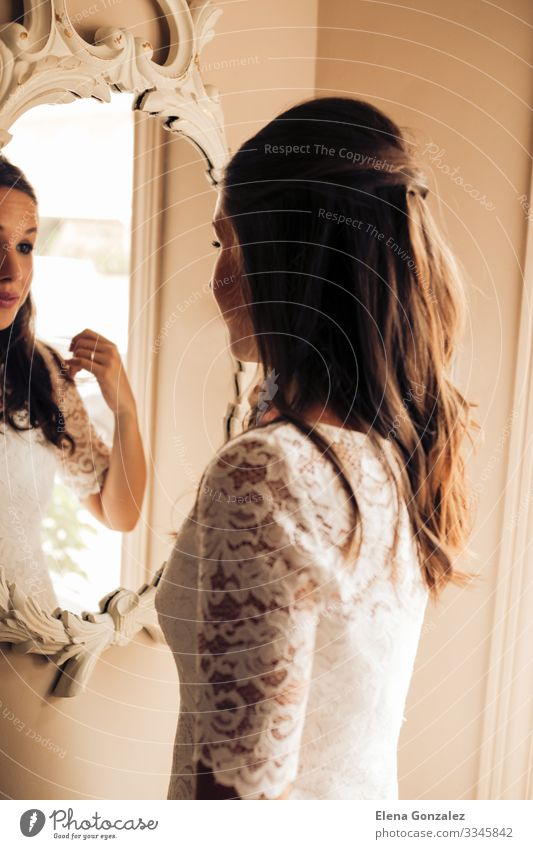 Bride before the wedding looking at the mirror. Lifestyle Elegant Mirror Wedding Feminine Woman Adults Youth (Young adults) Rose Love Nerviness Idea Arrangement