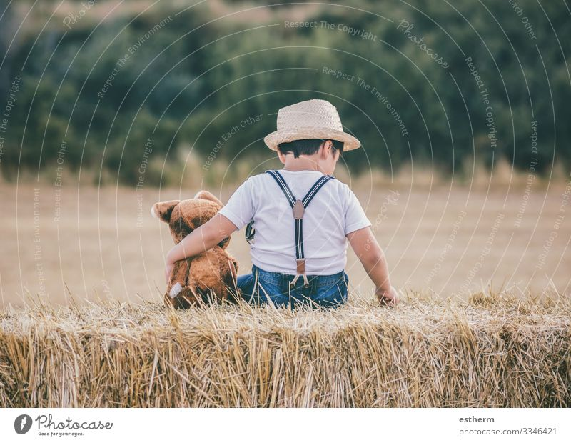 Boy hugging teddy bear in the wheat field Child Human being Vacation & Travel Nature Summer Landscape Joy Love Family & Relations Playing Freedom Together