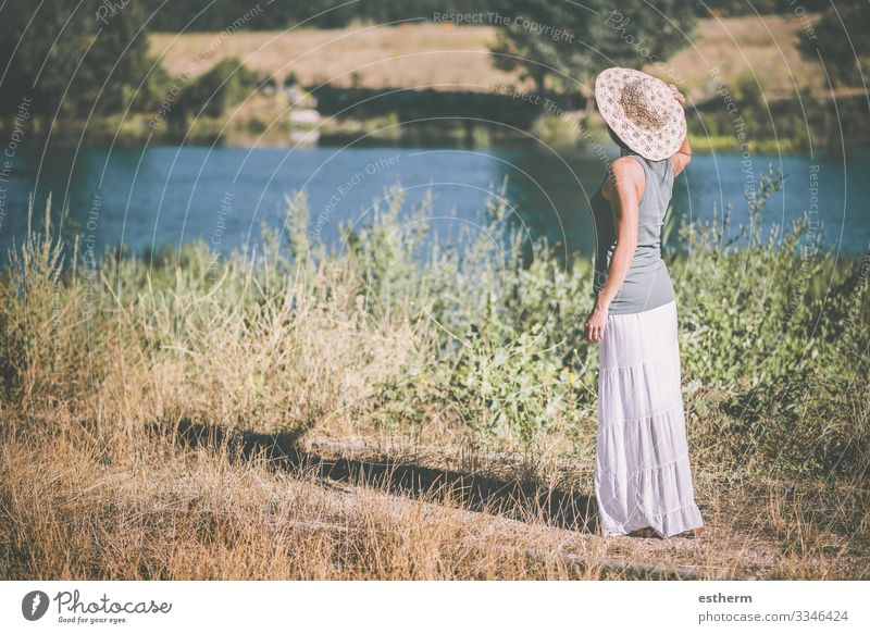 Young woman in the field Lifestyle Beautiful Relaxation Leisure and hobbies Vacation & Travel Freedom Summer Human being Feminine Youth (Young adults) Woman