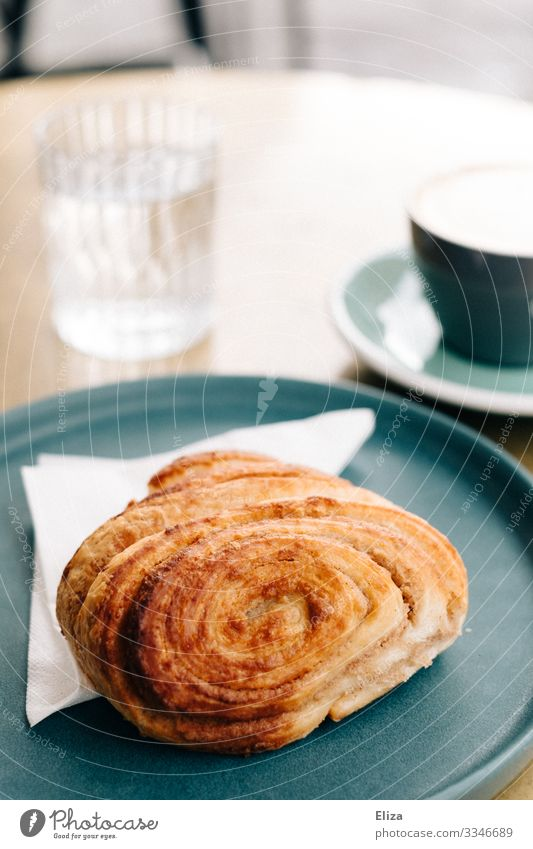 Delicious Franz roll Breakfast To have a coffee Coffee Café Dessert Baked goods French roll Sweet Candy Coffee break Table Tumbler Plate To enjoy Colour photo