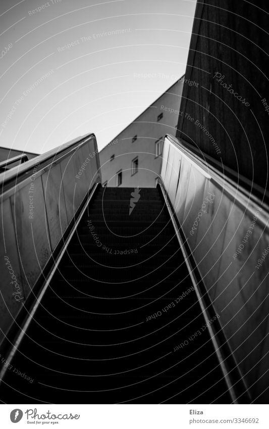 upward Escalator Planning Target Upward Subway station Stairs Lanes & trails Career Dark Canyon Middle Threat Go up Tall Future Steep End Black & white photo