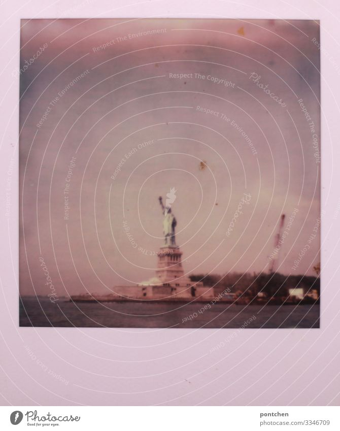 Polaroid shows Statue of Liberty in water in front of cloudy sky New York City USA Town Capital city Landmark Monument Statue of liberty Freedom Sky trump Water