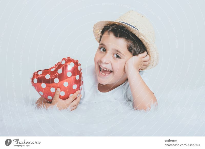 Smiling child with a heart-shaped balloont on white background Lifestyle Joy Health care Medication Feasts & Celebrations Valentine's Day Mother's Day