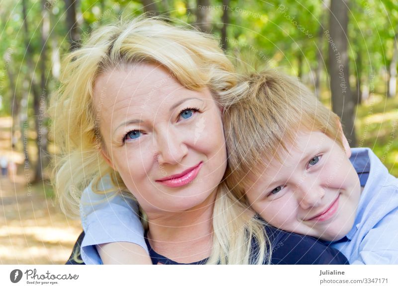 Portrait of mother and son Child Schoolchild Boy (child) Woman Adults Man Infancy 18 - 30 years Youth (Young adults) Nature Autumn Blonde White girl Caucasian