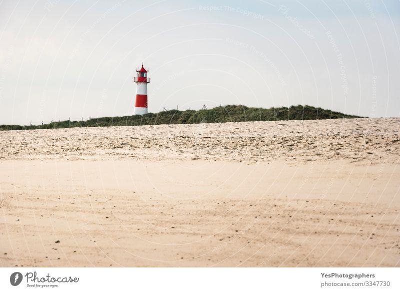 Lighthouse on beach on sunny summer day on Sylt island Relaxation Summer Beach Nature Sand Beautiful weather Hill Coast North Sea Building Red White Frisia