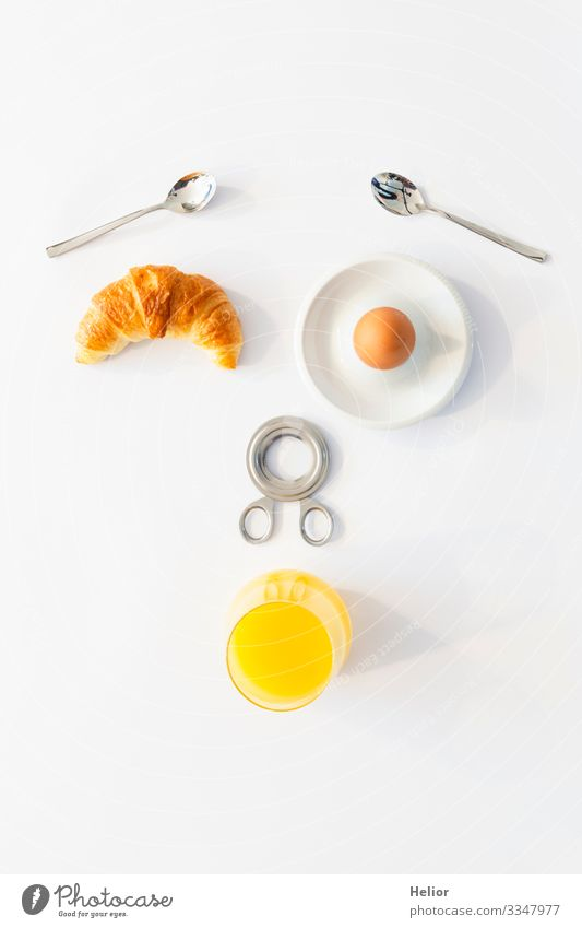 Funny breakfast concept with an abstract human face Croissant Beverage Juice Plate Spoon Joy Well-being Relaxation Eating Androgynous Face Glass Metal Drinking