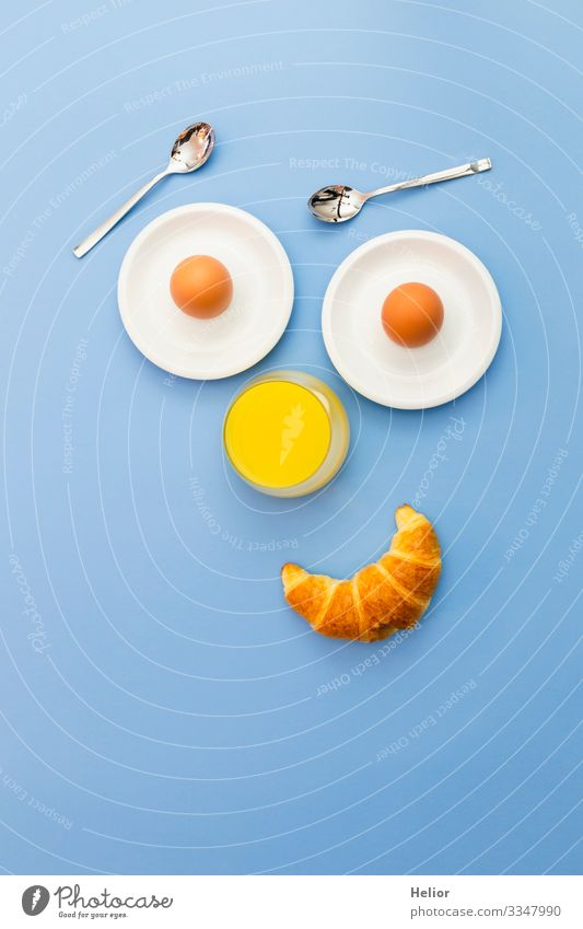 Funny breakfast concept with an abstract human face Croissant Breakfast Beverage Juice Plate Spoon Joy Relaxation Eating Androgynous Face Smiling Looking