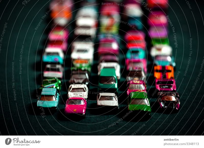 Toy jam Car Driving mass Crowd of people Replication Row Toys Model car Toy car Tracks Traffic jam Stand Street Road traffic Speed Transport Many Full Crowded