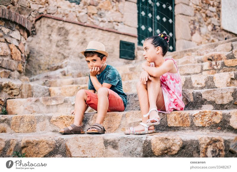 Two bored children sitting on a stairs on a summer day Lifestyle Face Leisure and hobbies Vacation & Travel Summer Summer vacation Garden Child Human being