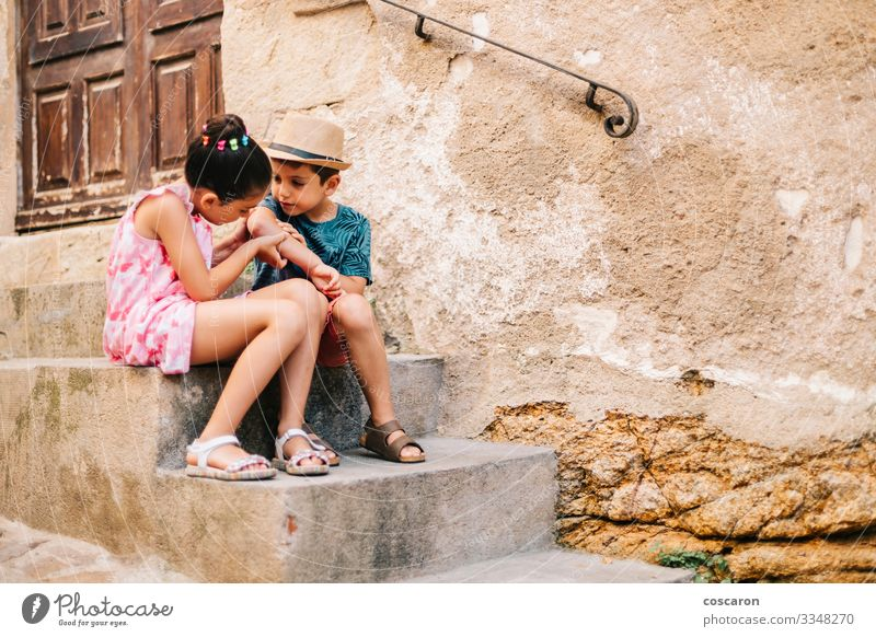 Girl healing a boy a wound in a summer day Lifestyle Beautiful Skin Health care Medical treatment Illness Medication Leisure and hobbies Playing