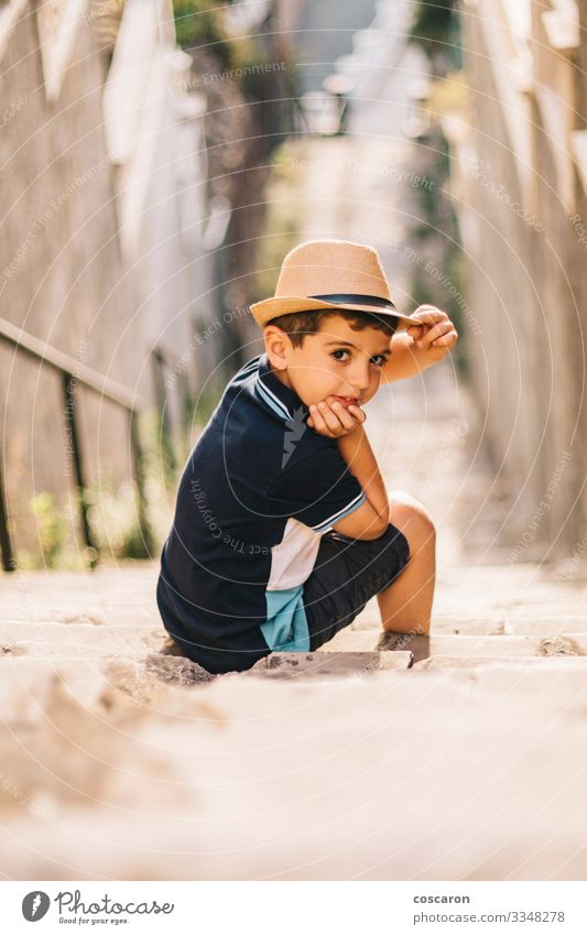 Portrait of a cute boy with hat on a stairs Lifestyle Style Joy Happy Beautiful Summer Summer vacation Sun Child Camera Human being Toddler Boy (child) Infancy