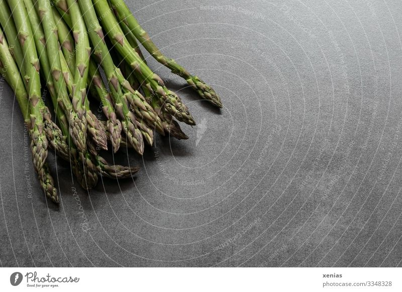 fresh green asparagus on grey worktop Asparagus Food Vegetable Asparagus season Nutrition Organic produce Vegetarian diet vegetable asparagus Stone Fresh