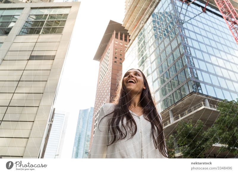 Young Indian Woman Smiling in Big City Beautiful Success Adults Youth (Young adults) High-rise Happiness Hope Future girl Financial District Marvel strive