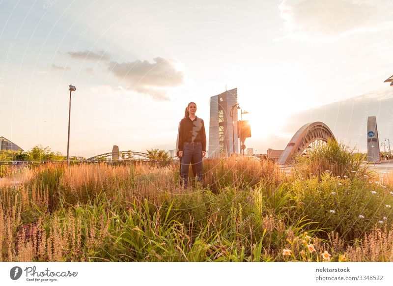 Young Woman Standing in Tall Grass Success Adults Youth (Young adults) Bridge Contentment dancing back to back girls dancers real life real people two women