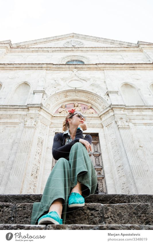 Young female traveler sitting on church steps in old town in Tuscany, Italy Lifestyle Vacation & Travel Tourism Trip Sightseeing City trip Human being Feminine