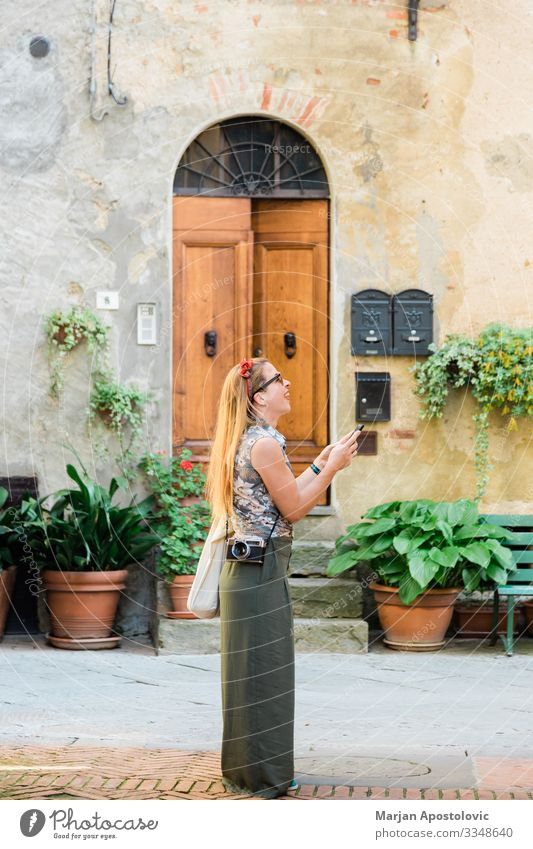 Young woman in an old town in Italy Lifestyle Joy Vacation & Travel Tourism Trip Sightseeing City trip Cellphone Camera Human being Feminine