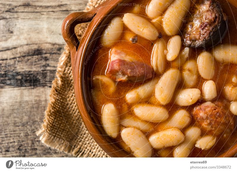 Typical Spanish fabada asturiana Healthy Eating Food photograph Dish Wood Tradition Dinner Meat Home-made Beans Sauce Ham Stew Bacon