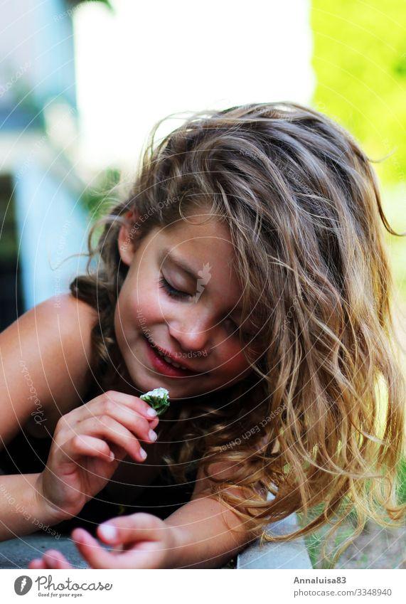little flowers Feminine Child Girl Hair and hairstyles Face 1 Human being 3 - 8 years Infancy Sunlight Flower Grass Blossom Garden Park Meadow Blonde