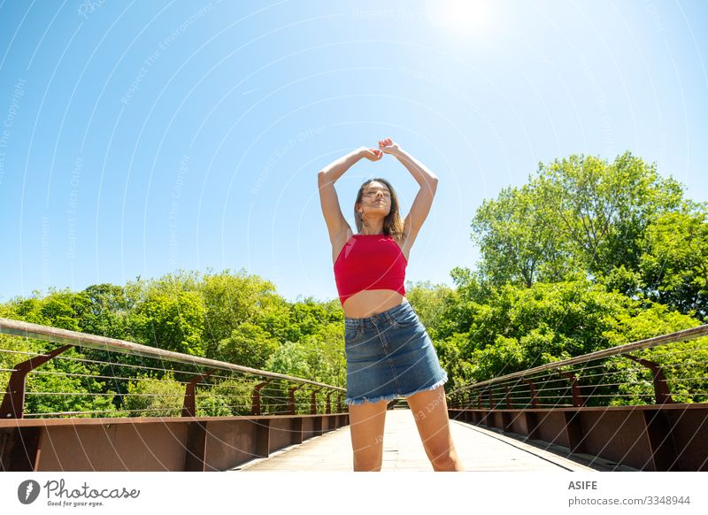 Young woman enjoying the sun and the nature Lifestyle Joy Happy Beautiful Relaxation Leisure and hobbies Summer Sun Woman Adults Youth (Young adults) Arm Nature