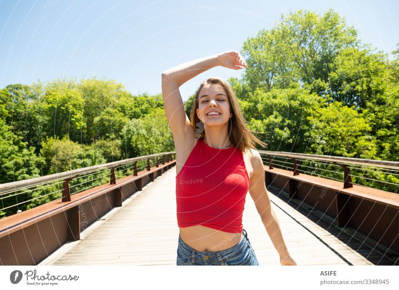 Happy and beautiful young woman enjoying the sun in a park Lifestyle Joy Beautiful Relaxation Leisure and hobbies Summer Sun Woman Adults Youth (Young adults)