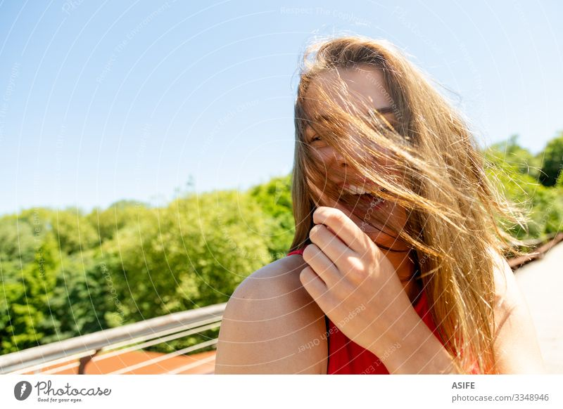 Portrait of a funny young woman enjoying the sun in a park Lifestyle Joy Happy Beautiful Face Relaxation Leisure and hobbies Summer Sun Woman Adults