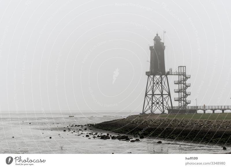 Tower in the fog Clouds Autumn Winter Bad weather Fog Rain Coast North Sea Mud flats Harbour Lighthouse Footbridge Mole Stairs Roof Esthetic Dark Elegant
