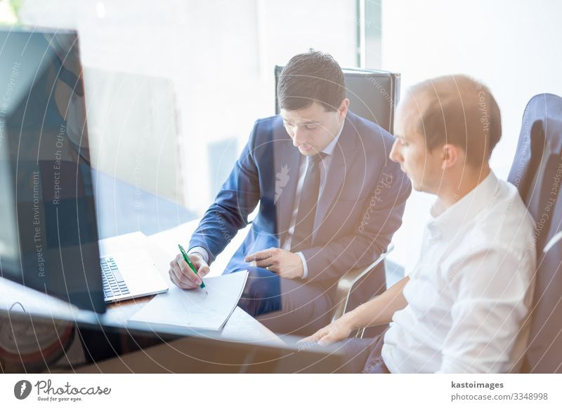 Two businessmen discussing bisiness problem. Elegant Work and employment Office Business Career Meeting To talk Screen Technology Human being Man Adults Partner