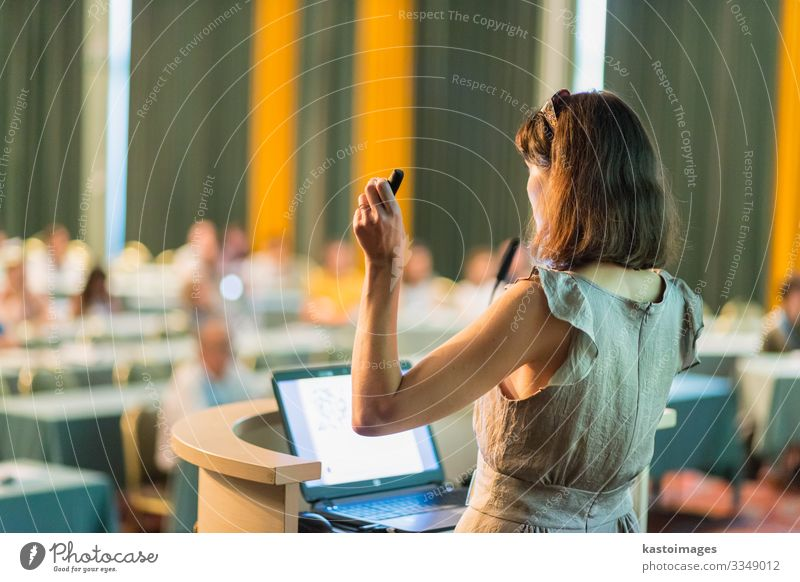 Speaker at Business Conference and Presentation. Audience Adult Education Teacher Academic studies Lecture hall Meeting Computer Notebook Screen Woman Adults